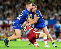 Wigan Warriors' Tom Davies is tackled by Warrington Wolves 's Jack Hughes and Bodene Thompson<br /> <br /> Photographer Alex Dodd/CameraSport<br /> <br /> Betfred Super League Grand Final - Wigan Warriors v Warrington Wolves - Saturday 13th October 2018 - Old Trafford - Manchester<br /> <br /> World Copyright © 2018 CameraSport. All rights reserved. 43 Linden Ave. Countesthorpe. Leicester. England. LE8 5PG - Tel: +44 (0) 116 277 4147 - admin@camerasport.com - www.camerasport.com