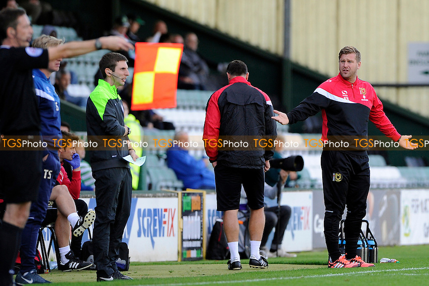 MK Dons Manager Karl Robinson questions a call by the linesman - Yeovil Town vs Mlton Keynes Dons - Sky Bet League One Football at Huish Park, Yeovil - 04/10/14 - MANDATORY CREDIT: Denis Murphy/TGSPHOTO - Self billing applies where appropriate - contact@tgsphoto.co.uk - NO UNPAID USE