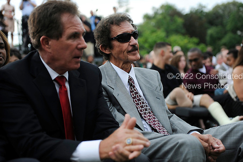 Washington, DC - August 19, 2009 -- 7 time NASCAR Champion Richard Petty (R) and 3 time NASCAR Champion Darrell Waltrip (L) wait prior to United States President Barack Obama greeting 2008 Sprint Cup Champion Jimmie Johnson during a ceremony on the South Lawn of the White House in Washington, D.C. USA 19 August 2009.  .Credit: Shawn Thew - Pool via CNP