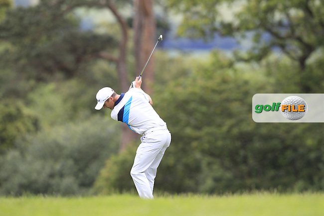 Michael Hoey (NIR) plays his 2nd shot on the 14th hole during Sunday's Final Round of the 2014 Irish Open held at Fota Island Resort, Cork, Ireland. 22nd June 2014.<br /> Picture: Eoin Clarke www.golffile.ie
