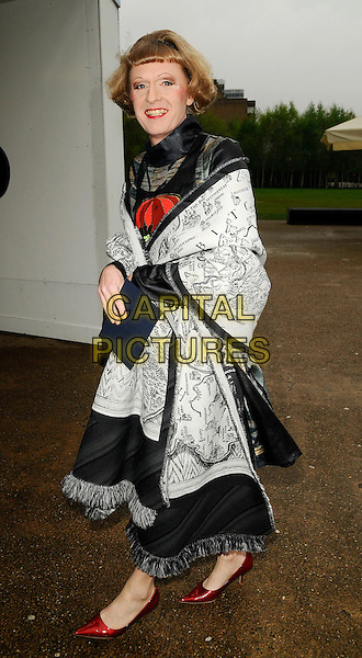 GRAYSON PERRY.The Montblanc De La Culture Arts Patronage Award, Tate Modern, South Bank, London, England, April 16th 2009..full length cross dresser wig black and grey gray wrap shawl red shoes tassels .CAP/CAN.©Can Nguyen/Capital Pictures