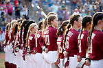 OKLAHOMA CITY, OK - JUNE 04: The Florida State Seminoles listen to the national anthem during the Division I Women's Softball Championship held at USA Softball Hall of Fame Stadium - OGE Energy Field on June 4, 2018 in Oklahoma City, Oklahoma. (Photo by Shane Bevel/NCAA Photos via Getty Images)