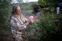 Maryann Pratt picks a flowed on her rural Arizona ranch.  (Pat Shannahan/ The Arizona Republic)