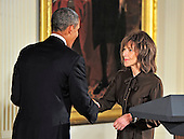 Elaine May, right, shakes hands with United States President Barack Obama, left, prior to accepting the 2012 National Medal of Arts during the presentation ceremony in the East Room of the White House in Washington, D.C. on Wednesday, July 10, 2013.<br /> Credit: Ron Sachs / CNP