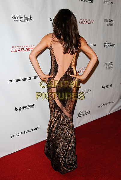 NATASHA PAVLOVICH .arriving at the 7th Annual Living Legends of Aviation Awards at the Beverly Hilton Hotel in Beverly Hills, California, USA, January 22nd, 2010.  .arrivals full length hands on hips brown beige cut out mesh sheer see through figure hugging tight dress long maxi bronze back rear behind backless fishnet .CAP/ROT.©Lee Roth/Capital Pictures.