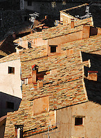 View from above of the rooftops, Albarracin, Teruel, Spain, on February 13, 2006, pictured in the morning. Albarracin, a beautiful village with National Monument status overlooking the Guadalivar River, lies 28 km from Teruel, in the National Park in the Montes Universales. It is on the border of three Spanish Kingdoms: Castille, Aragon and Valencia, has been occupied for hundreds of years and is known as the Eagles` Nest because it  is built on a steep outcrop of rock surrounded by a deep gorge, a natural defence. Its buildings show  Moorish influence and even the name may derive from  the Berber clan Banu Razin who settled in the area during the 9th century. At the top of the village is the 10th century Moorish castle, reached through cobbled streets of  houses constructed of wood and plaster with small windows whose tiled roofs are seen here.  Picture by Manuel Cohen.