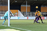 Rushian Hepburn-Murphy of Cambridge United beats Mitchell Clark of Port Vale to the ball but hits the post with a diving header during Cambridge United vs Port Vale, Sky Bet EFL League 2 Football at the Cambs Glass Stadium on 9th February 2019