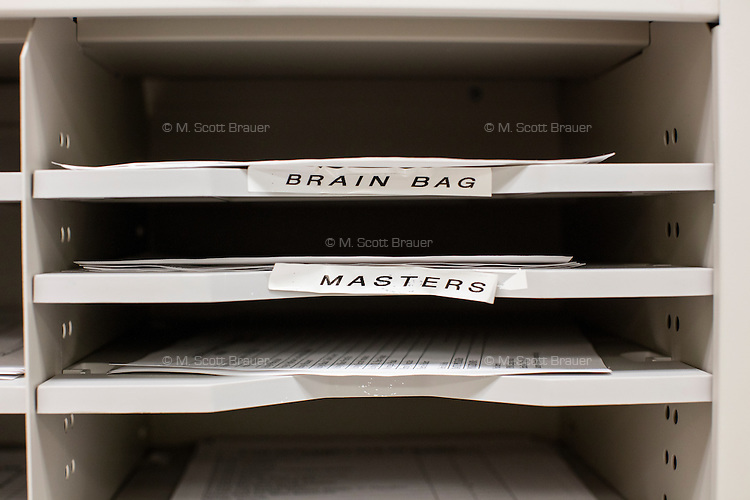 """Labels including """"brain bags"""" and """"blue cornea bags"""" indicate supplies in a room at the New England Organ Bank, an organ procurement organization based in Waltham, Massachusetts, serving the greater New England area."""