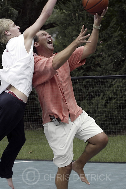 07/13/2004 -- Severna Park, MD --  Steve Bisciotti plays basketball with his son Jack, 16, on his outdoor haf basketball court at his Severna Park home. We are profiling new Ravens owner Steve Bisciotti. reporter Jamison hensley will be at Bisciotti's house tomorrow for the interview. Shoot Bisciotti by himself, with his family, etc. CHRIS DETRICK/BALTIMORE SUN STAFF ELECTRONIC IMAGE #816G1280 No Mags, No Sales, No Internet, No TV
