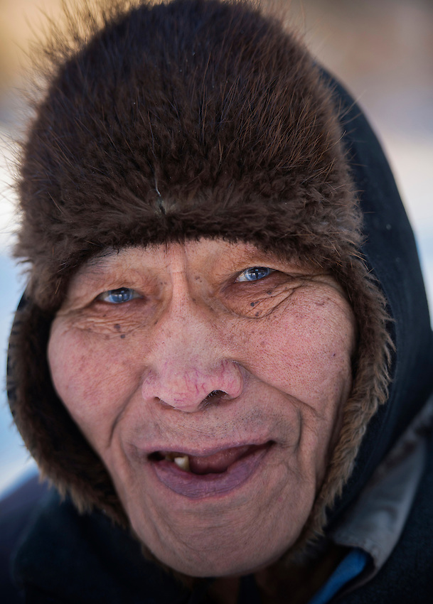 79-year-old Alexie Gusty outside his home in Stony River, Alaska. Photo by James R. Evans