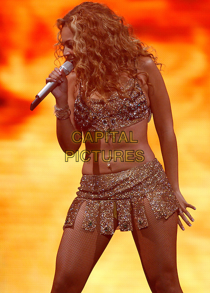 BEYONCE KNOWLES.Performs at the Final show of The Verizon Ladies First Tour 2004 held at The Pond of Anaheim in Anaheim,California on .April 21,2004.half length, half-length, belly, stomach, midriff, concert, live, music, gig, singing.www.capitalpictures.com.sales@capitalpictures.com.Supplied By Capital Pictures