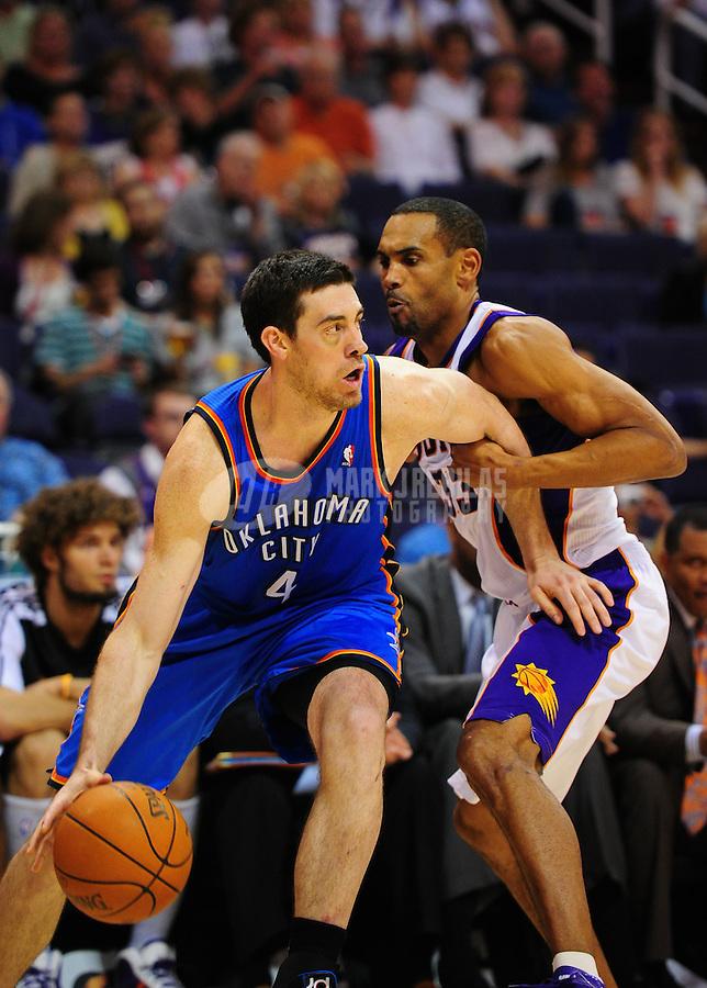 Mar. 30, 2011; Phoenix, AZ, USA; Oklahoma City Thunder forward (4) Nick Collison against Phoenix Suns forward (33) Grant Hill at the US Airways Center. Mandatory Credit: Mark J. Rebilas-