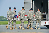 A transfer case containing the remains of Staff Sergeant Michael H. Ollis, United States Army, are transferred by an Army transfer team during a Dignified Transfer ceremony at Dover AFB in Dover, Delaware on Saturday, August 31, 2013.  Ollis died supporting Operation Enduring Freedom in Afghanistan.<br /> Credit: Ron Sachs / CNP<br /> (RESTRICTION: NO New York or New Jersey Newspapers or newspapers within a 75 mile radius of New York City)