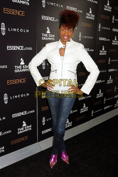 N'DAMBI (Chonita Gilbert).Essence Salutes Grammy Nominated Artist Janelle Monae at the 2nd Annual Essence Black Women in Music Event held at Playhouse Hollywood, Hollywood, California, USA..February 9th, 2011.full length white jacket jeans denim hands on hip pink pointy shoes leather.CAP/ADM/BP.©Byron Purvis/AdMedia/Capital Pictures.
