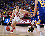 SIOUX FALLS, SD: MARCH 6: Matt Mooney #13 from the University of South Dakota gets a step past Tevin King #2 from South Dakota State University during the Summit League Basketball Championship on March 6, 2017 at the Denny Sanford Premier Center in Sioux Falls, SD. (Photo by Dave Eggen/Inertia)
