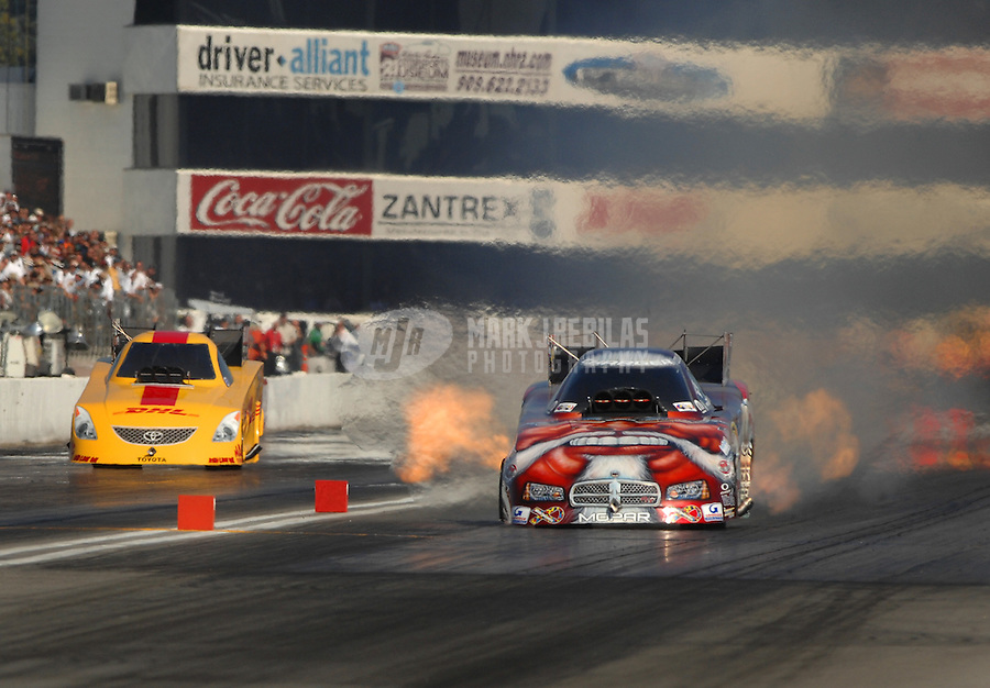 Nov 3, 2007; Pomona, CA, USA; NHRA funny car driver Mike Ashley (right) leads Scott Kalitta during qualifying for the Auto Club Finals at Auto Club Raceway at Pomona. Mandatory Credit: Mark J. Rebilas-US PRESSWIRE