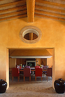 The large fireplace that is used to heat the dining room, and also occasionally for cooking, is framed by the arch linking the living room to the dining room