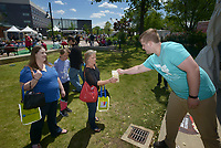 NWA Democrat-Gazette/BEN GOFF @NWABENGOFF<br /> Matt Barson hands out free popcorn Thursday, May 4, 2017, at Lawrence Plaza during the Bentonville Film Festival.