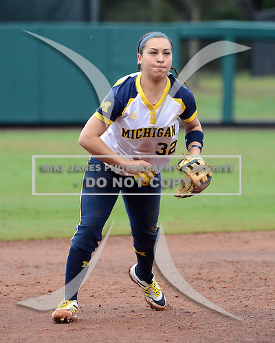 Michigan Wolverines shortstop Sierra Romero (32) flips the ball to third during the season opener against the Florida Gators on February 8, 2014 at the USF Softball Stadium in Tampa, Florida.  Florida defeated Michigan 9-4 in extra innings.  (Copyright Mike Janes Photography)