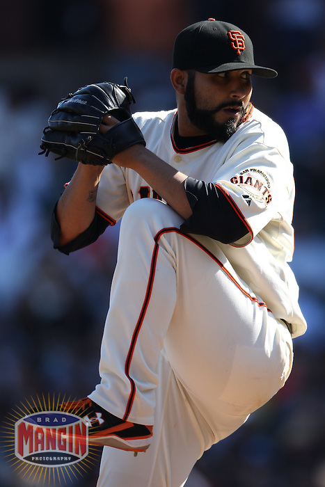 SAN FRANCISCO - SEPTEMBER 30:  Sergio Romo #54 of the San Francisco Giants pitches against the Arizona Diamondbacks during the game at AT&T Park on September 30, 2010 in San Francisco, California. Photo by Brad Mangin