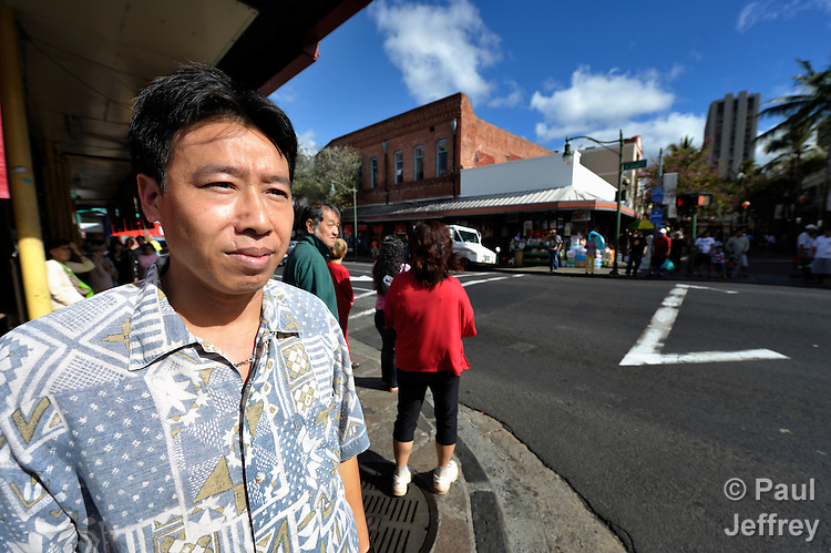 Hieu Van Bui, a Vietnamese survivor of human trafficking, walks through the Chinatown neighborhood of Honolulu, Hawaii. He has received assistance from the Susannah Wesley Community Center, which has played a key role in identifying and supporting victims of trafficking in Hawaii.