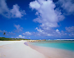 Anguilla, BWI: A white san beach and blue waters compliment the colors of the clouds and sky overhead on Savannah Bay on the north shore of Anguilla