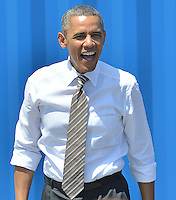 MIAMI, FL - MARCH 29: President Barack Obama approaches the podium during an event at PortMiami in Miami, Florida. The president spoke about road and bridge construction during the event at the port in Miami, where he also toured a new tunnel project on March 29, 2013 in Miami, Florida.<br /> <br /> People:  President Barack Obama<br /> <br /> Transmission Ref:  FLXX<br /> <br /> Must call if interested<br /> Michael Storms<br /> Storms Media Group Inc.<br /> 305-632-3400 - Cell<br /> 305-513-5783 - Fax<br /> MikeStorm@aol.com