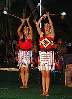 Two Maori girls twirl poi balls at a Polynesian show in Waikiki on O'ahu.