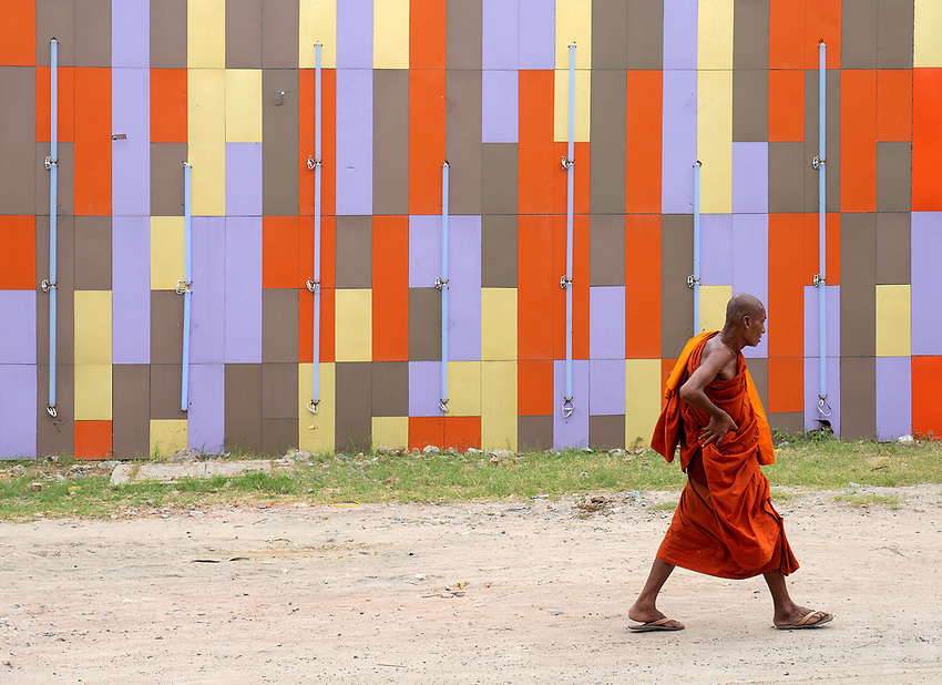 "Street scene a buddhist Monk walking in front of a new Karaoke Bar in Mandalay ""The new Myanmar"""
