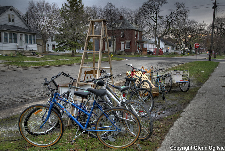 Bikes, a wagon and furniture are for sale at a  second hand shop on Forsyth and Davis Streets, Sarnia.