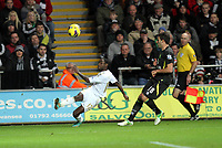 Barclays Premier League, Swansea City (White) V Norwich City (black) Liberty Stadium, Swansea, 08/12/12<br /> Pictured: Swansea's Nathan Dyer only just gets this cross off<br /> Picture by: Ben Wyeth / Athena <br /> Athena Picture Agency<br /> info@athena-pictures.com