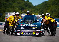 Jun 16, 2018; Bristol, TN, USA; NHRA Safety Safari crew members push the car of funny car driver Matt Hagan during qualifying for the Thunder Valley Nationals at Bristol Dragway. Mandatory Credit: Mark J. Rebilas-USA TODAY Sports