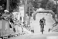 A Rwandan rider persists in continuing the race, even if he has been dropped and is more then 10 minutes behind the first riders as the crowd up 23rd Street cheers even harder for him then they did before.<br /> <br /> U23 Road Race<br /> UCI Road World Championships Richmond 2015 / USA