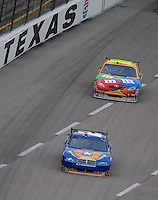 Nov. 8, 2009; Fort Worth, TX, USA; NASCAR Sprint Cup Series driver Kurt Busch (2) leads brother Kyle Busch (18) during the Dickies 500 at the Texas Motor Speedway. Mandatory Credit: Mark J. Rebilas-