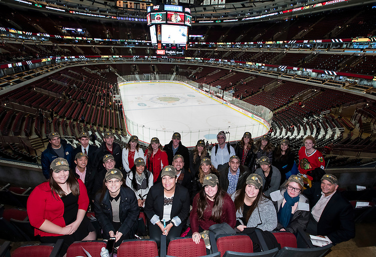 "DePaul University Driehaus College of Business students pose for a picture inside the United Center, home of the Chicago Blackhawks NHL hockey team, during their class ""Behind the Scenes with Chicago Sports Organizations"" Tuesday, Dec. 1, 2015. Throughout the week-long course, students participated in behind the scenes tours of sports organizations and venues to gain first hand insights into the sports business landscape of Chicago. (DePaul University/Jeff Carrion)"