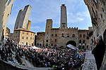 Riders line up in Piazza Duomo, San Gimignano before the start of the 2014 Strade Bianche race over the white dusty gravel roads of Tuscany running 200km from San Gimignano to Siena, Italy. 8th March 2014.<br /> Photo: Gian Mattia D'Alberto/LaPresse/www.newsfile.ie