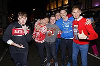 Pictured: Christmas revellers in Wind Street, Swansea, Wales, UK. Friday 20 December 2019<br /> Re: Black Eye Friday (also known as Black Friday, Mad Friday, Frantic Friday) the last Friday before Christmas, in Swansea, Wales, UK.