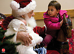 BETHLEHEM, CT - 05 DECEMBER 2008 -120508JT02-<br /> Audrey Allard, 19 months, of Watertown, looks at Santa Claus as he talks to her while posing for a photo with Audrey's little brother Miles, 5 months, at Memorial Hall in Bethlehem during the opening of Bethlehem's 28th annual Christmas Town Festival on Friday. The festival continues into today from 10 a.m. to 4 p.m.<br /> Josalee Thrift / Republican-American