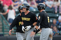 Jordan Luplow (center) is congratulated by teammates Tyler Filliben (left) and Kevin Newman (5) after hitting a 3-run home run against the Hickory Crawdads at L.P. Frans Stadium on August 15, 2015 in Hickory, North Carolina.  The Power defeated the Crawdads 9-0.  (Brian Westerholt/Four Seam Images)