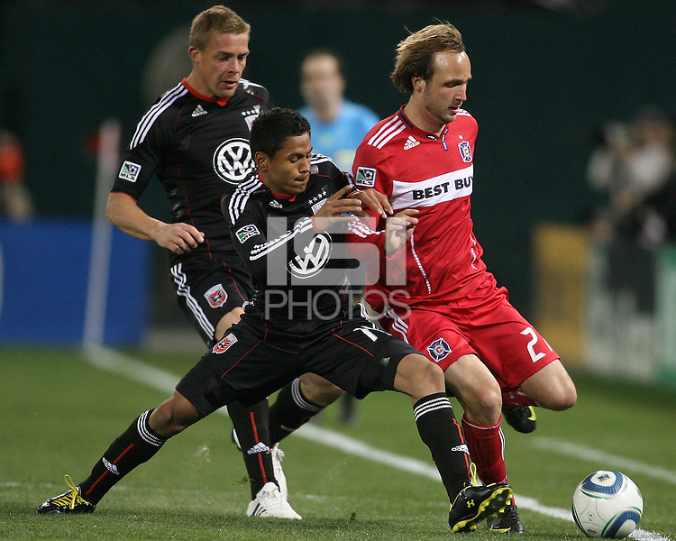 Andy Najar #14 of D.C. United pushes into Justin Mapp #21 of the Chicago Fire during an MLS match on April 17 2010, at RFK Stadium in Washington D.C.