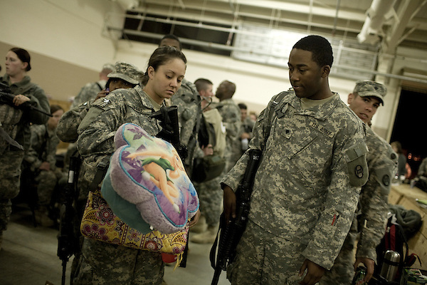 April 16, 2009. Pope Air Force Base, NC.. Members of the North Carolina National Guard's 30th Brigade Heavy Combat Team leave Pope Air Force Base for a 12 month tour in Iraq. In all, approximately 4,000 soldiers from the 30th HBCT are deploying and this will be the Brigade's 2nd deployment since 2003.. Soldiers prepare to board the plane.