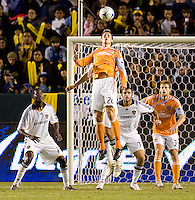 Houston Dynamo midfielder Stuart Holden leaps high for a head ball during the Western Conference Final. The LA Galaxy defeated the Houston Dynamo 2-1 to win the MLS Western Conference Final at Home Depot Center stadium in Carson, California on Friday November 13, 2009.....
