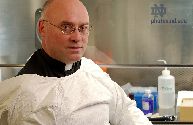 Rev. Tom Streit, C.S.C. in his Galvin Hall lab, 2003...Photo by Matt Cashore.
