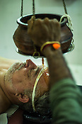 A resident guest gets the Shirovasti (oil over forehead) ayurvedic treatment at the Nagarjuna Ayurvedic Centre in Kerala, India.