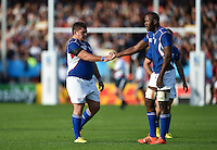 Casper Viviers of Namibia high-fives team-mate Tjiuee Uanivi. Rugby World Cup Pool C match between Tonga and Namibia on September 29, 2015 at Sandy Park in Exeter, England. Photo by: Patrick Khachfe / Onside Images
