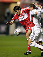 Chicago Fire defender Brandon Prideaux (6) tries to break free from Real Salt Lake forward Yuri Movsisyan (14).  Real Salt Lake defeated the Chicago Fire in a penalty kick shootout 0-0 (5-4 PK) in the Eastern Conference Final at Toyota Park in Bridgeview, IL on November 14, 2009.