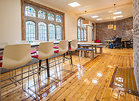 A general view of the interior of the 'Withington Works' co-working space at Withington Baths and Leisure Centre, Withington, Manchester on Wednesday 12th June 2019.