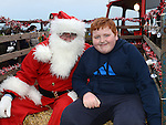 Oisín Matthews pictured with Santa when he visited Julianstown Community Gardens. Photo:Colin Bell/pressphotos.ie