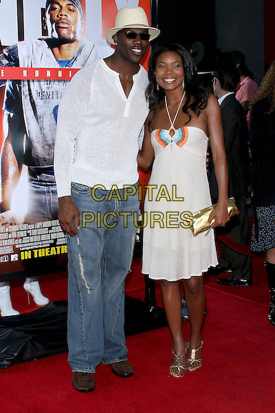 "TERRELL OWENS & GABRIELLE UNION.World Premiere of ""The Longest Yard"" held at Grauman's Chinese Theatre..May 19th, 2005.Photo Credit: Jacqui Wong/AdMedia.full length white dress gold cclutch purse jeans denim white shirt hat.www.capitalpictures.com.sales@capitalpictures.com.© Capital Pictures."