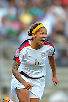 Action photo of Natasha Kai of United States celebrating goal against Costa Rica, during game of the Womens Preolympic soccer tournament held at Ciudad Juarez.